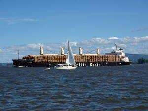 timber barge and sailboat